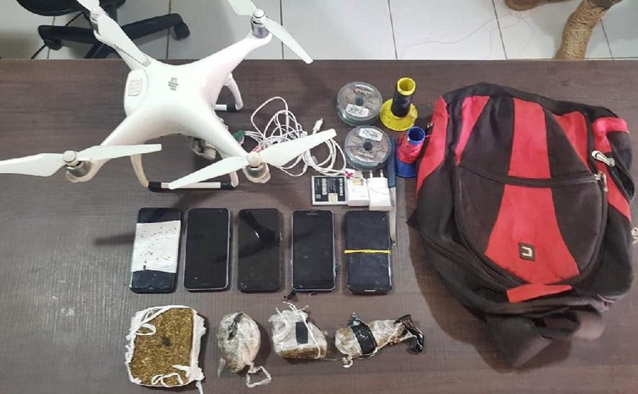 Imagem: drone e drogas Homem é preso após tentar 'jogar' drogas e celulares na Mata Grande